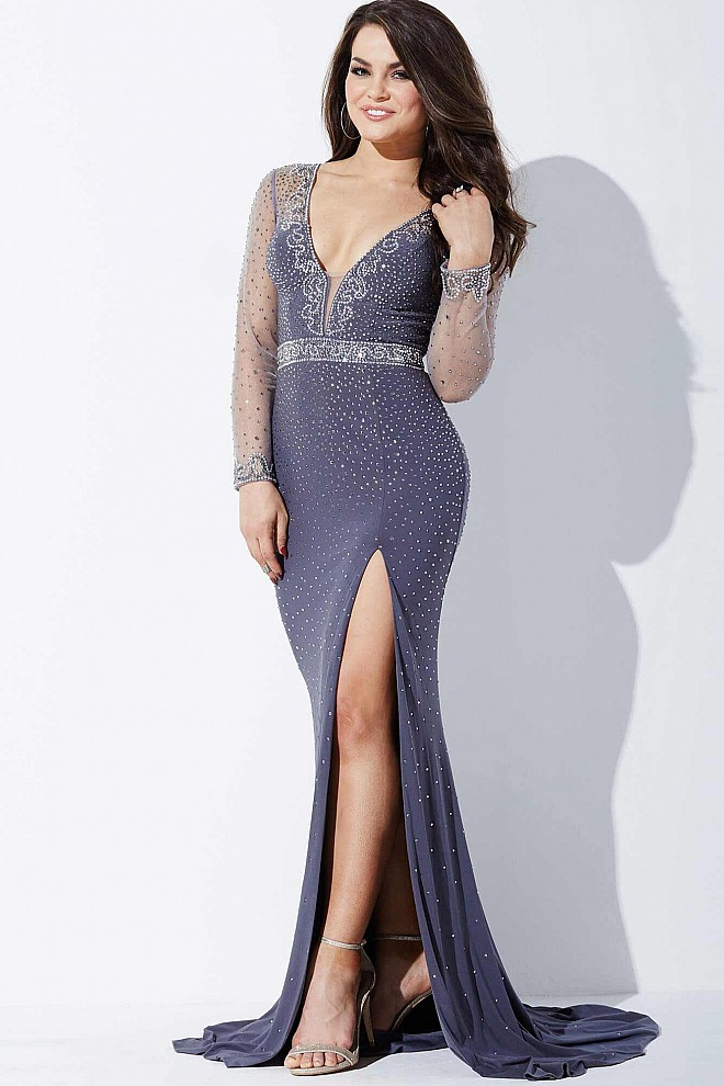 Sheer beaded long sleeve grey evening dress with plunging neckline.