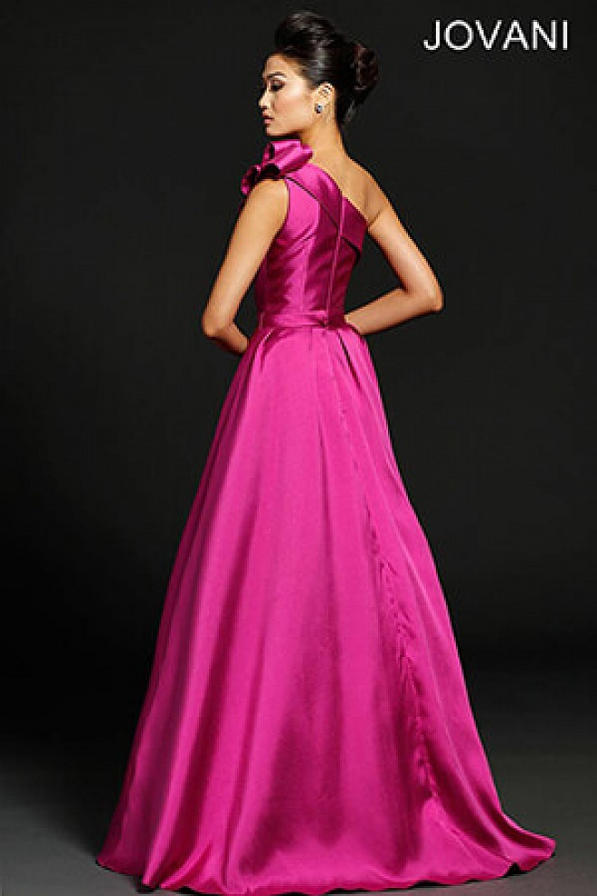 Fuchsia one shoulder taffeta prom ballgown with bow and side pockets.