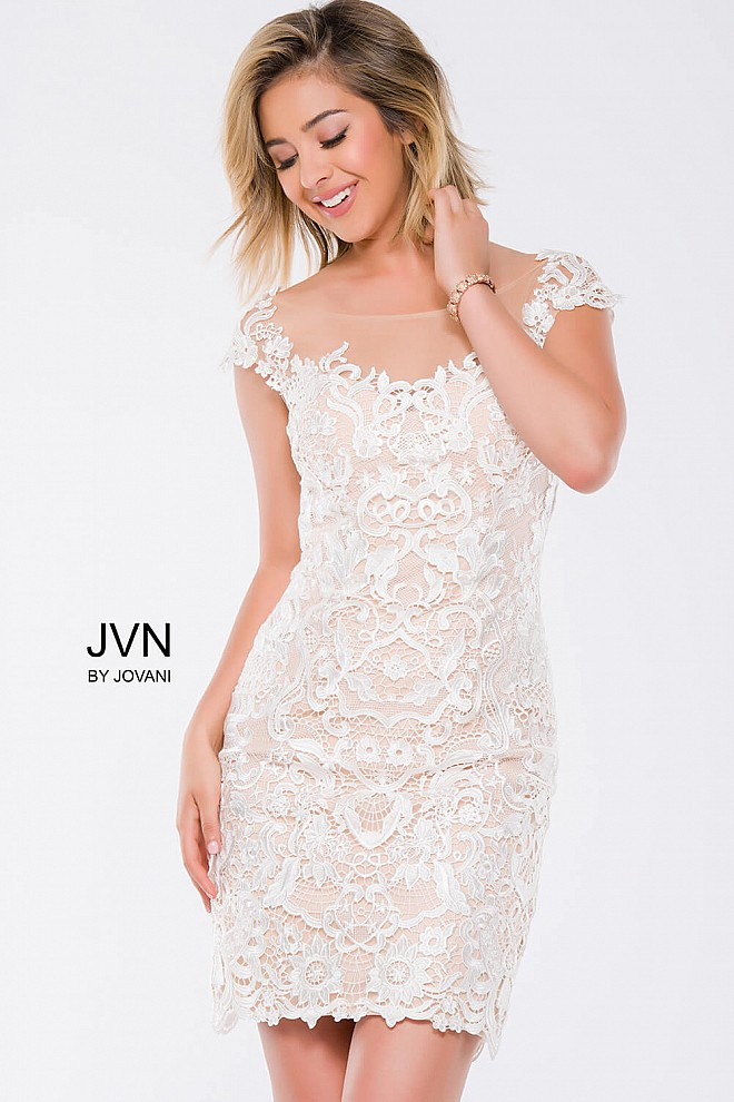 Ivory cap sleeve sheer neckline fit lace short dress with nude underlay.