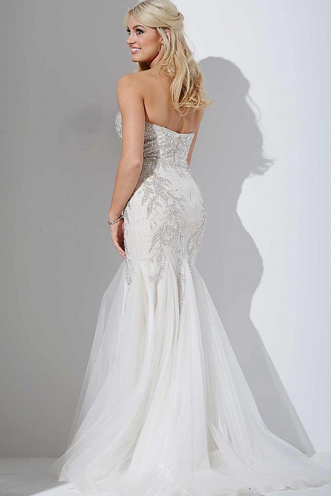 White trumpet dress with tulle skirt and beaded embellishments