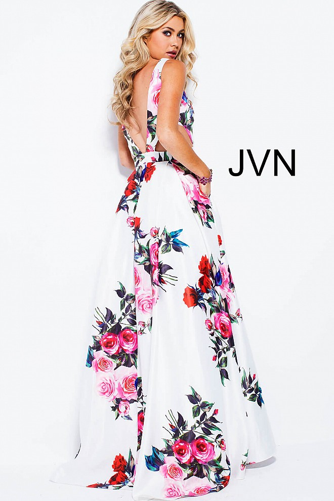 White multi print long A line sleeveless plunging v neck prom gown.