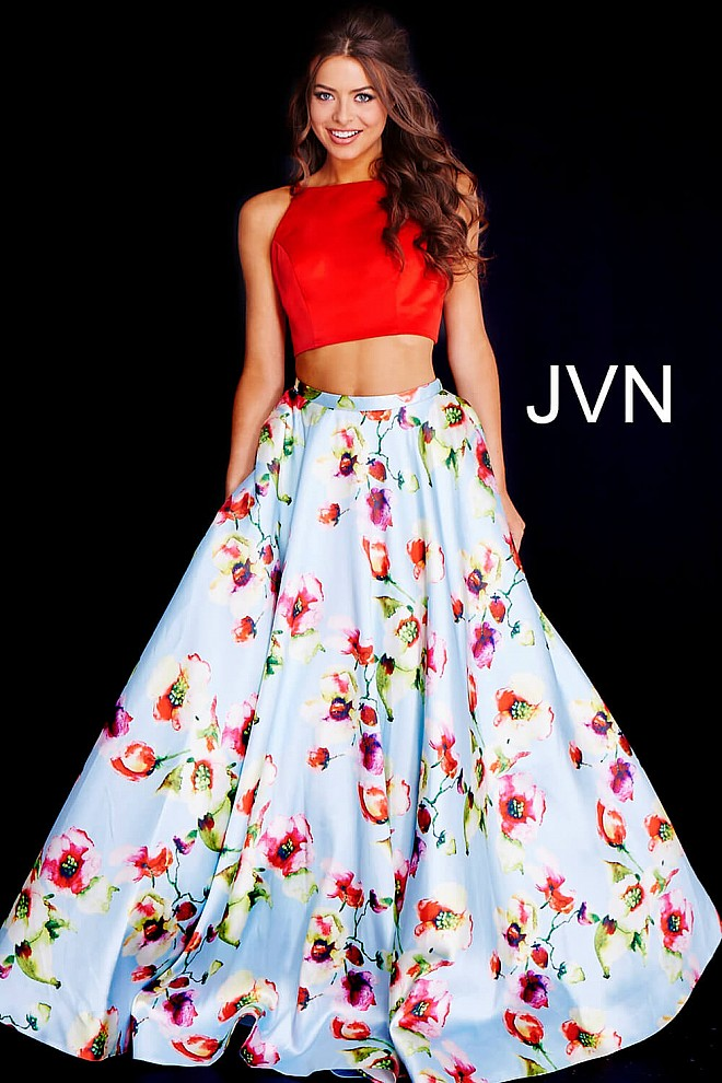 Red and blue two piece dress has a floral print skirt and sleeveless ...