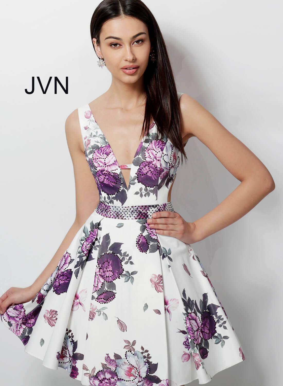 f253da37484 White print fit and flare side cut outs V neck V back dress.